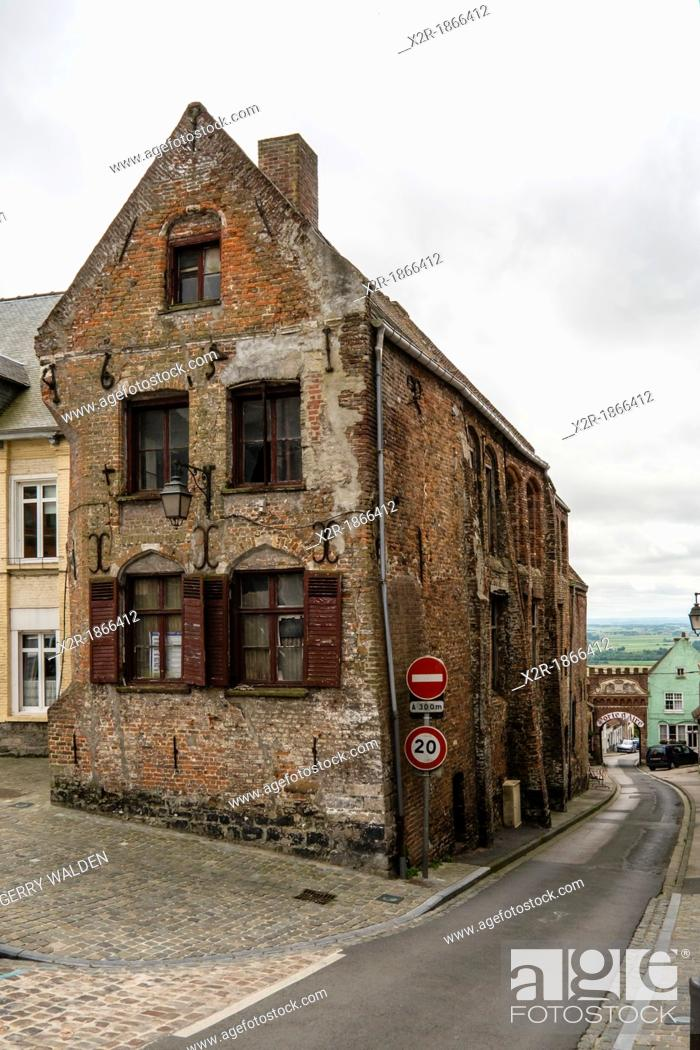 Stock Photo: Historic bulding and Porte d'Aire in the walled town of Cassel in Normandy, France.