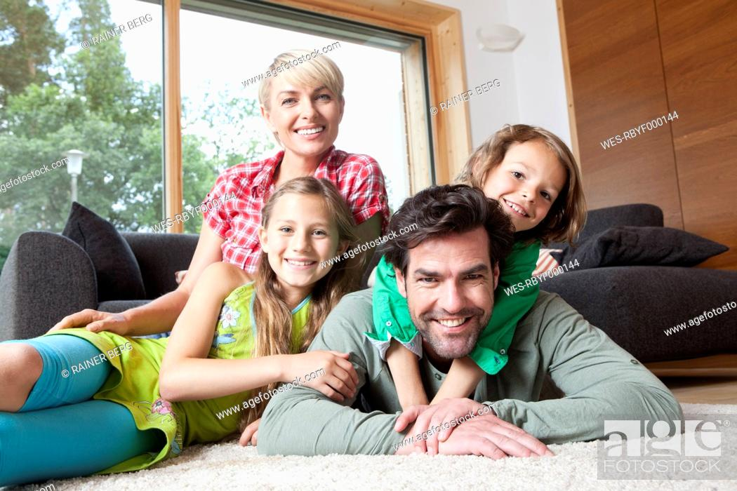 Stock Photo: Germany, Bavaria, Nuremberg, Portrait of family in living room.