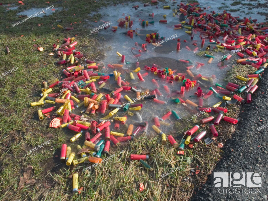 Stock Photo: Spent shotgun shells and pieces of clay pigeons lay on the ground at a shooting range in the United States.