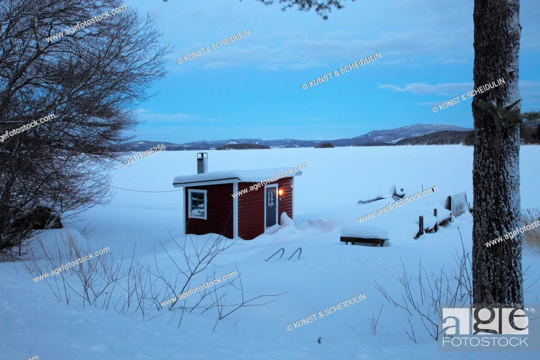 Stock Photo: Small red cabin at the shore of a bay of the Baltic Sea in Sweden.