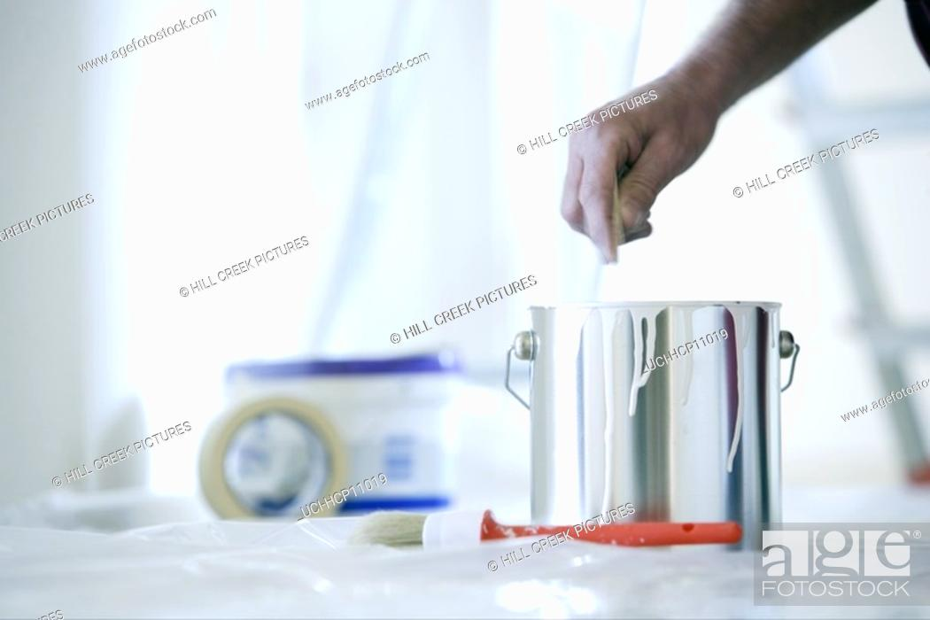 Stock Photo: Man mixing paint.