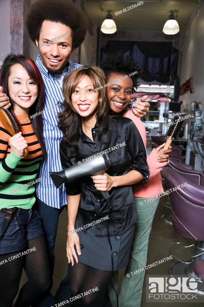 Stock Photo: Multi-ethnic hair stylists in salon.