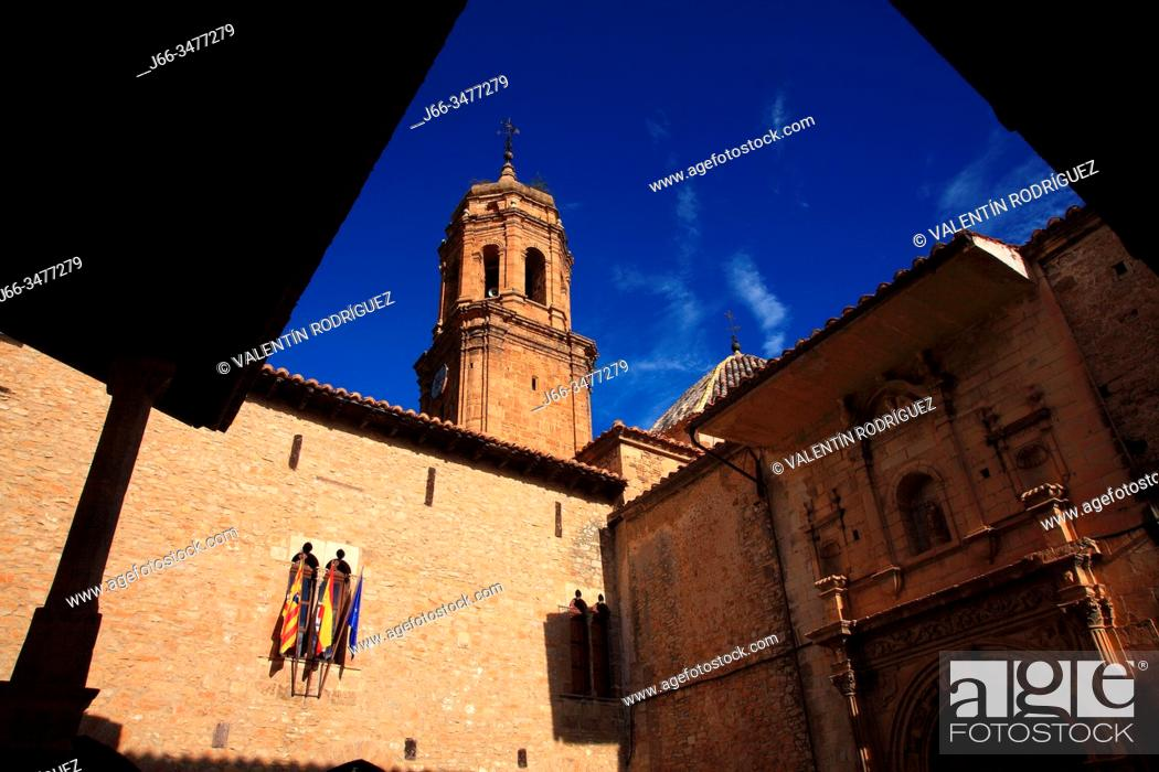 Stock Photo: Square with the twon hall and the church of the Purification in La Iglesuela del Cid. Teruel.