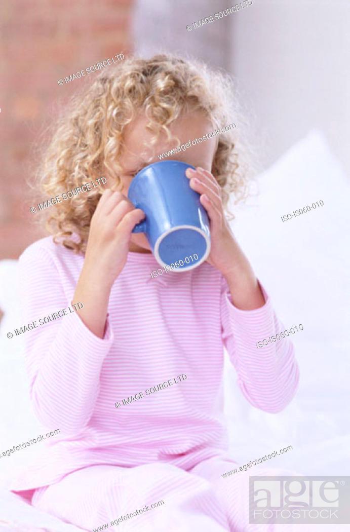 Stock Photo: Girl drinking tea.