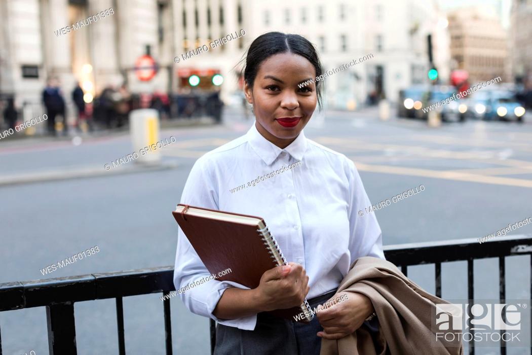 Stock Photo: UK, London, portrait of smiling businesswoman.
