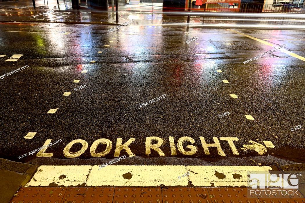 Stock Photo: Road marking on a rainy road, look right.