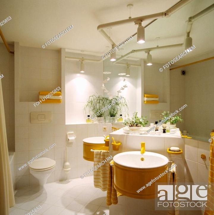 Track Lighting Above Yellow Basins On White Tiled Vanity Unit In Modern White Bathroom Stock Photo Picture And Rights Managed Image Pic Foh U10925853 Agefotostock