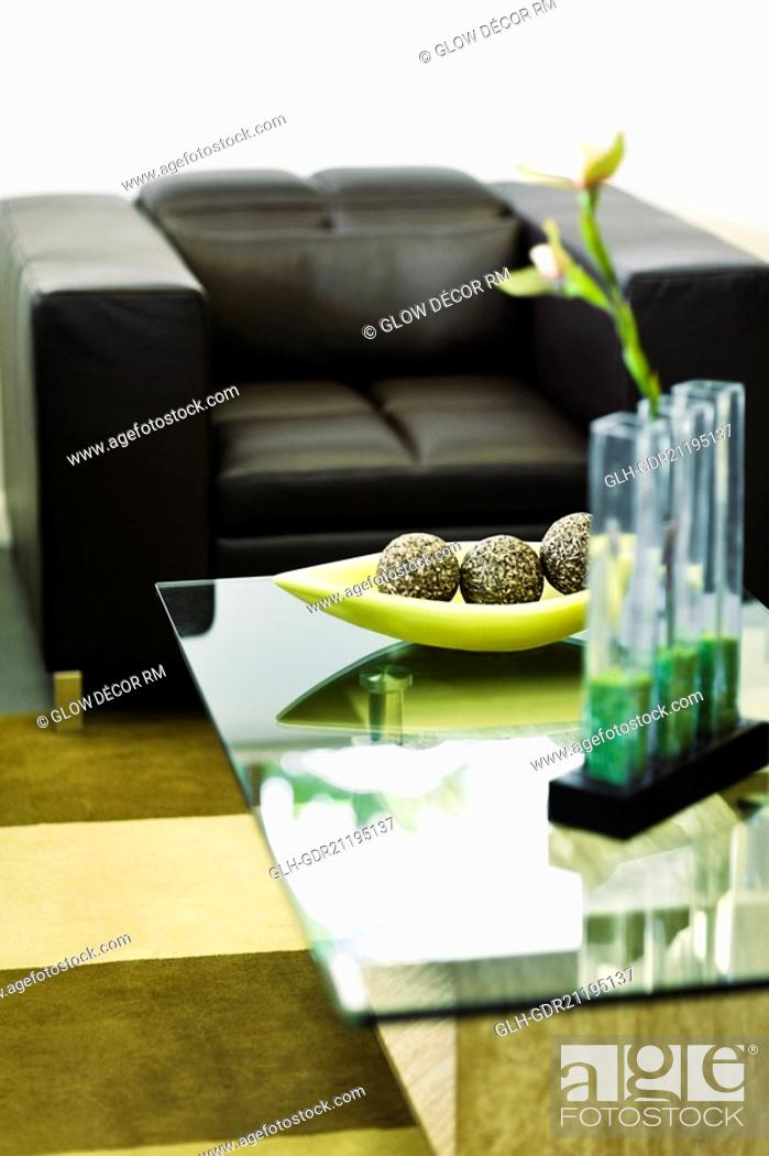 Stock Photo: Showpieces on a table with two seater sofa.