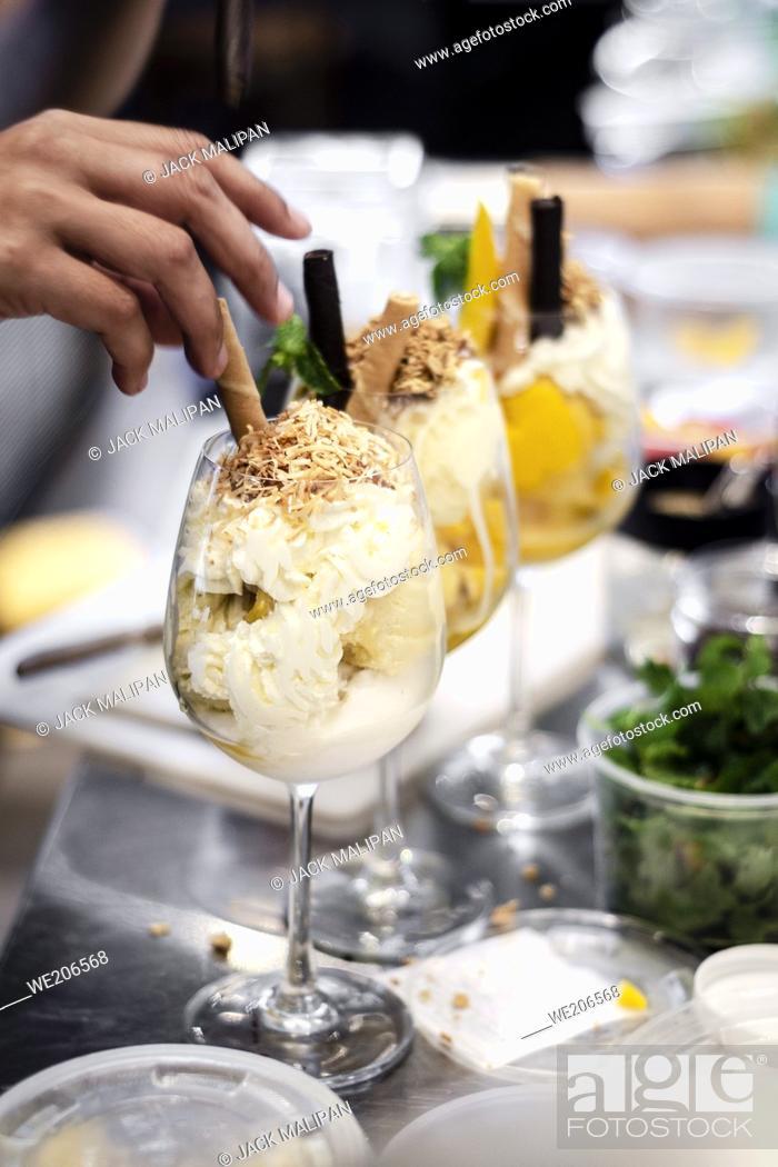 Stock Photo: detail of staff making italian gelato ice cream sundae in modern shop.