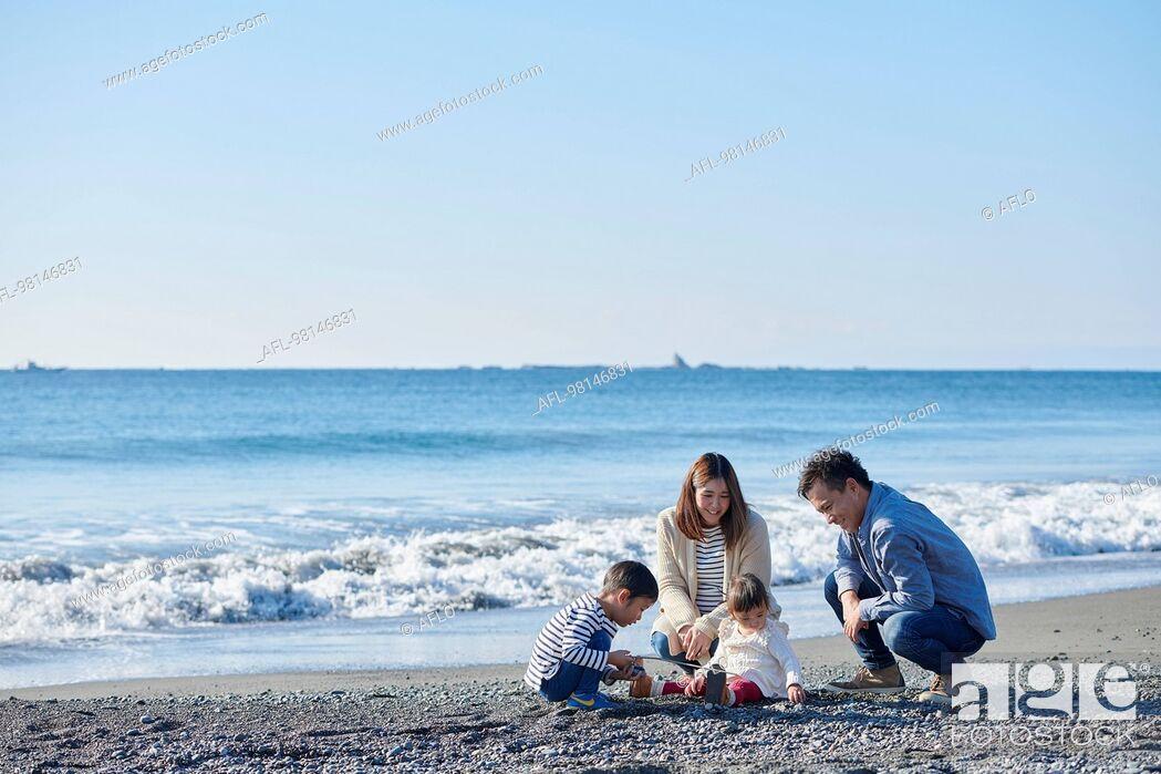 Stock Photo: Japanese family at the beach.