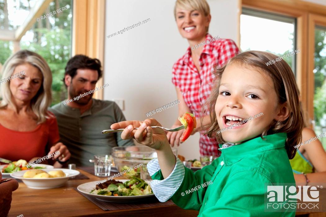 Stock Photo: Germany, Bavaria, Nuremberg, Family having lunch.