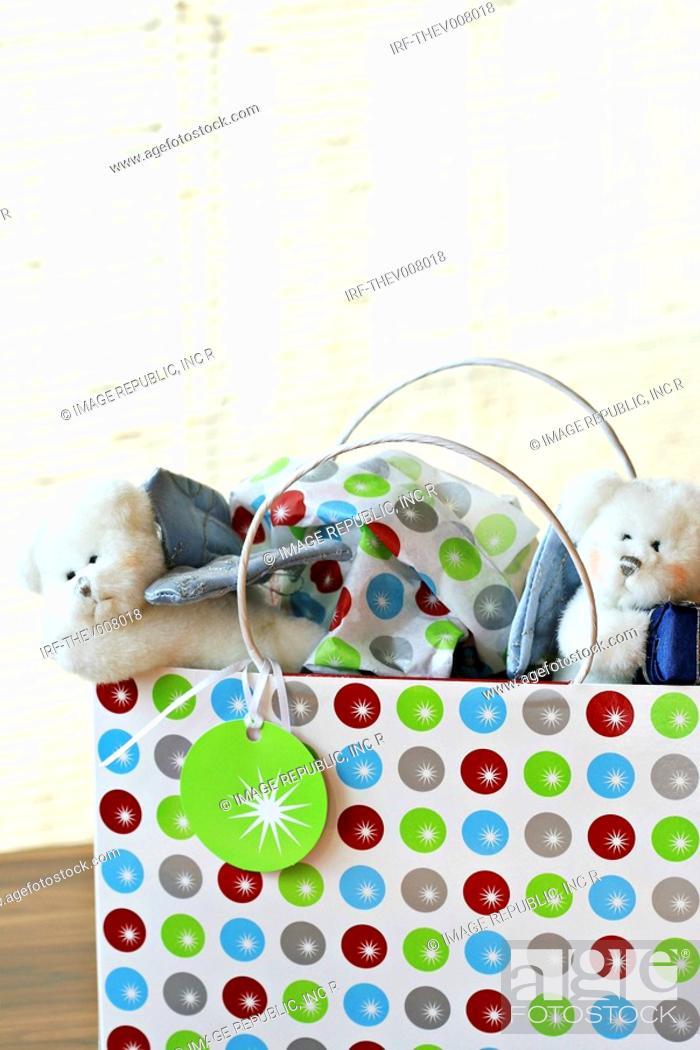 Stock Photo: dolls in shopping bag.
