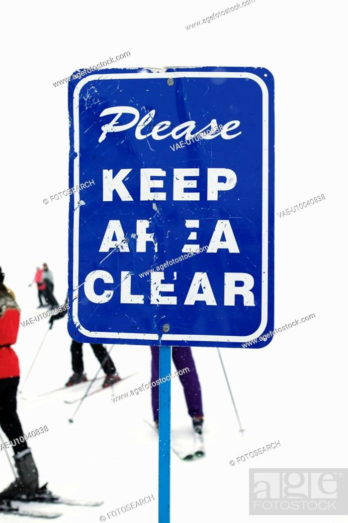 Stock Photo: Sign at ski slope requesting area be kept clear.