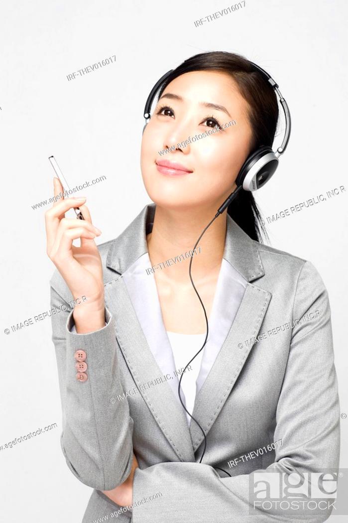 Stock Photo: businesswoman holding a pen.