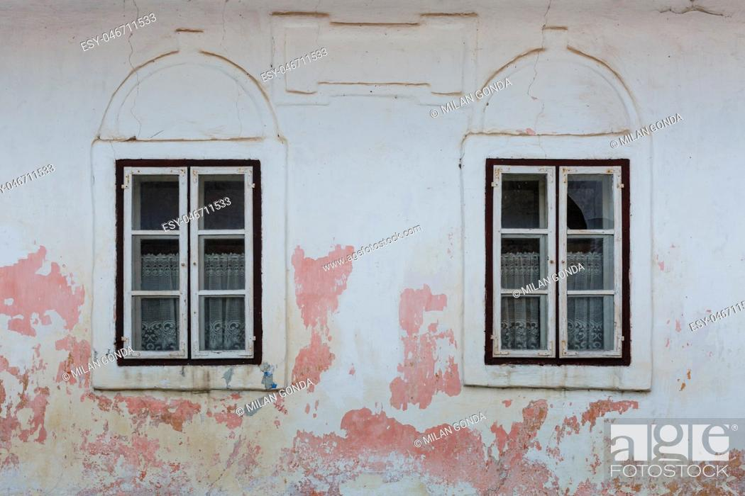 Stock Photo: Windows of a traditional house in Haj village, northern Slovakia.