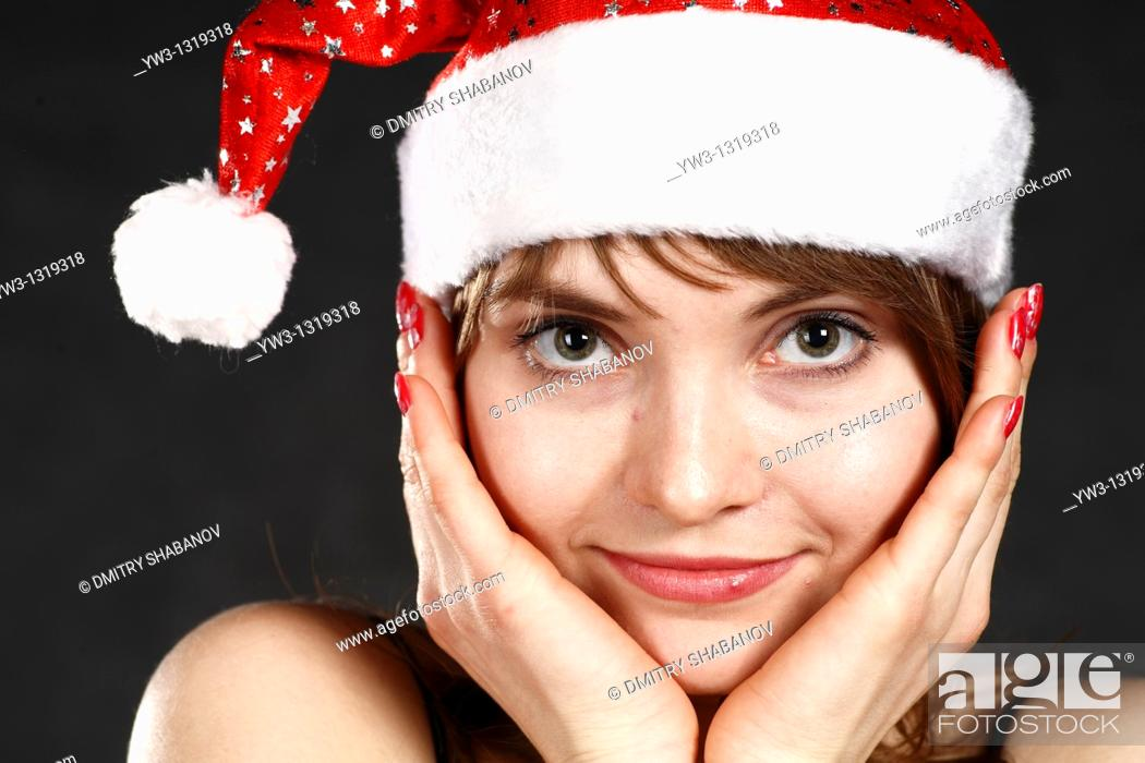 Stock Photo: Close-up portrait of a woman wearing a Christmas hat.