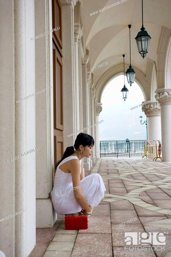 Stock Photo: Chinese woman at the Venetian Macao-Resort-Hotel, China.