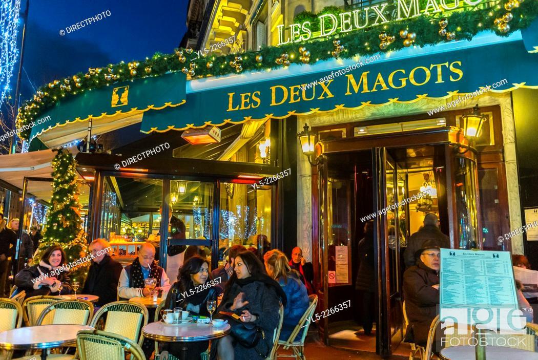 Stock Photo: Paris, France, Street Scenes, Tourists Sharing Drinks on Terrace of Les Deux Magots Café, in Latin Quarter, Saint Germain-des-Prés, at Night.