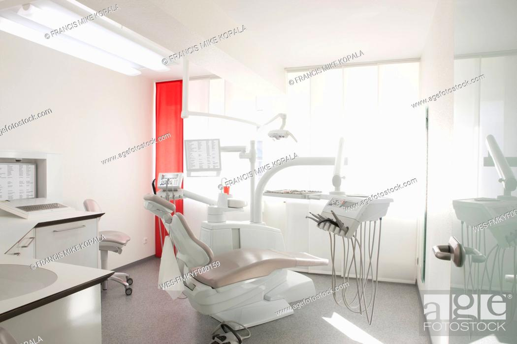 Stock Photo: Germany, Dentist chair and equipment in dental office.