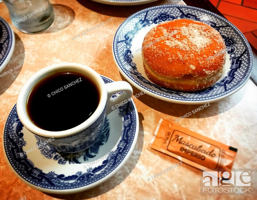 Stock Photo: A coffee cup and a sweet bread in Sanborns Restaurant in Coyoacan, Mexico.