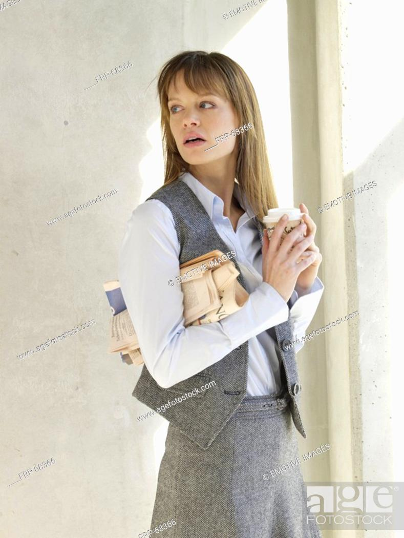 Stock Photo: Business woman holding a cup of coffee.
