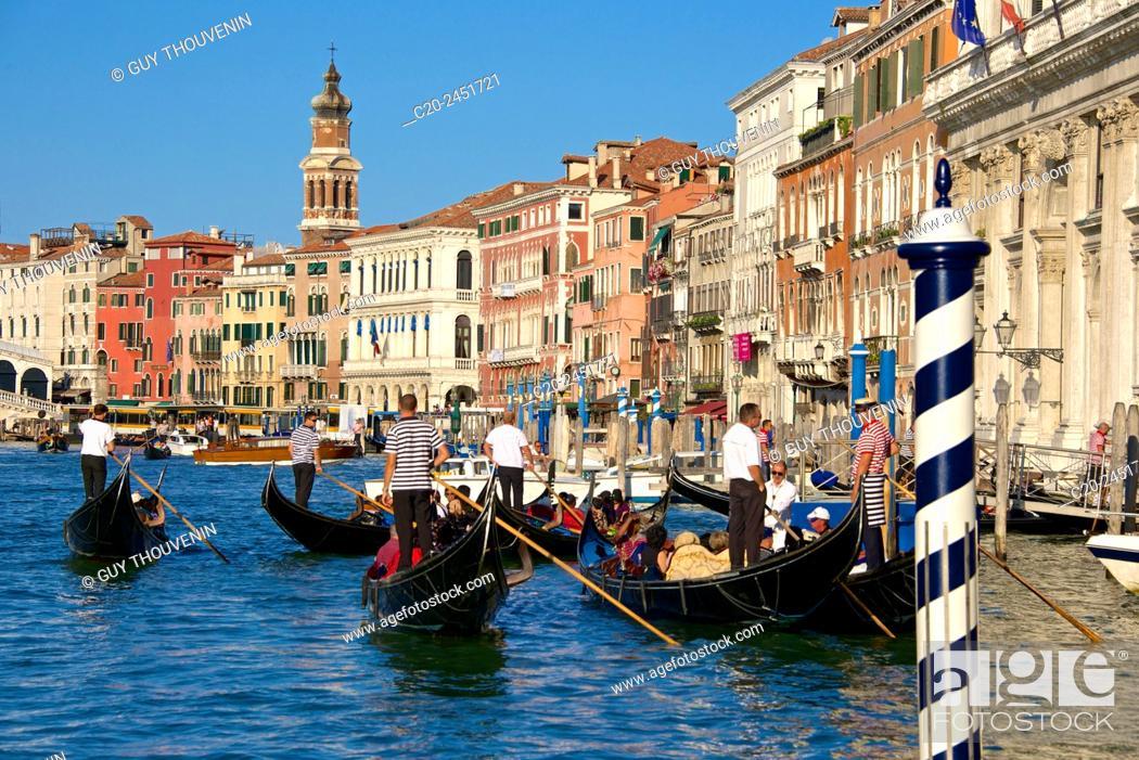 Stock Photo: Gondolas and gondoliers, Palaces facades, church steeple, Canal Grande, Venice, Venetia, Italy.