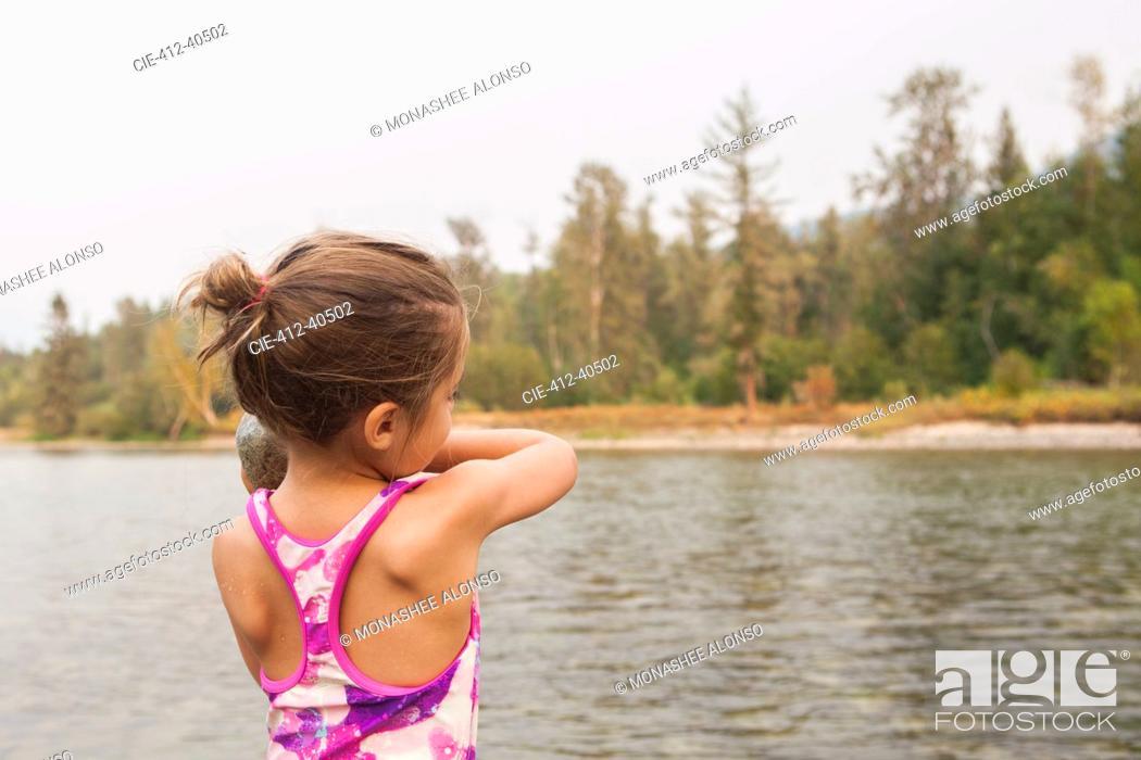 Photo de stock: Girl in bathing suit at lake.
