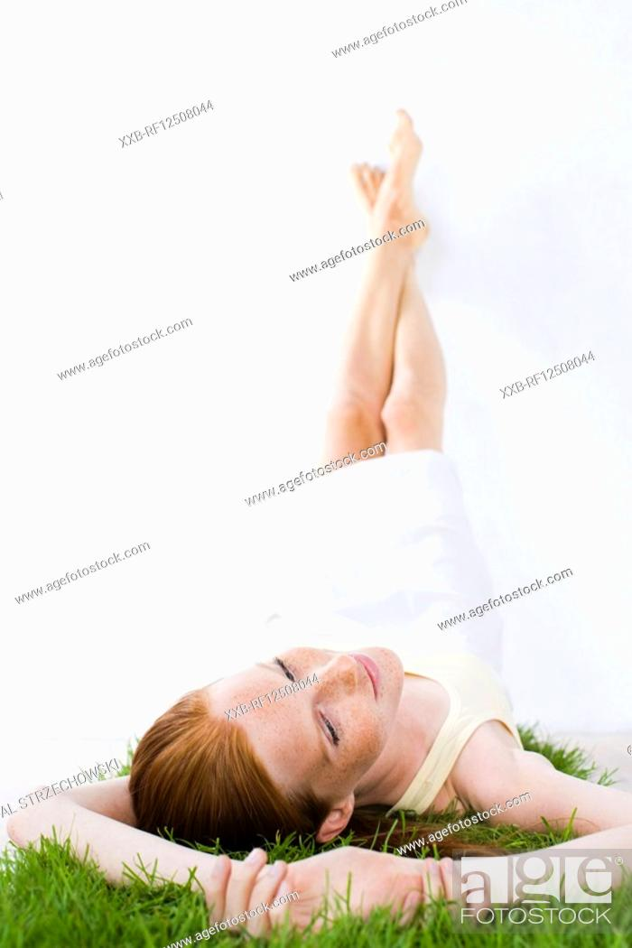 Stock Photo: beauty woman laying on grass.