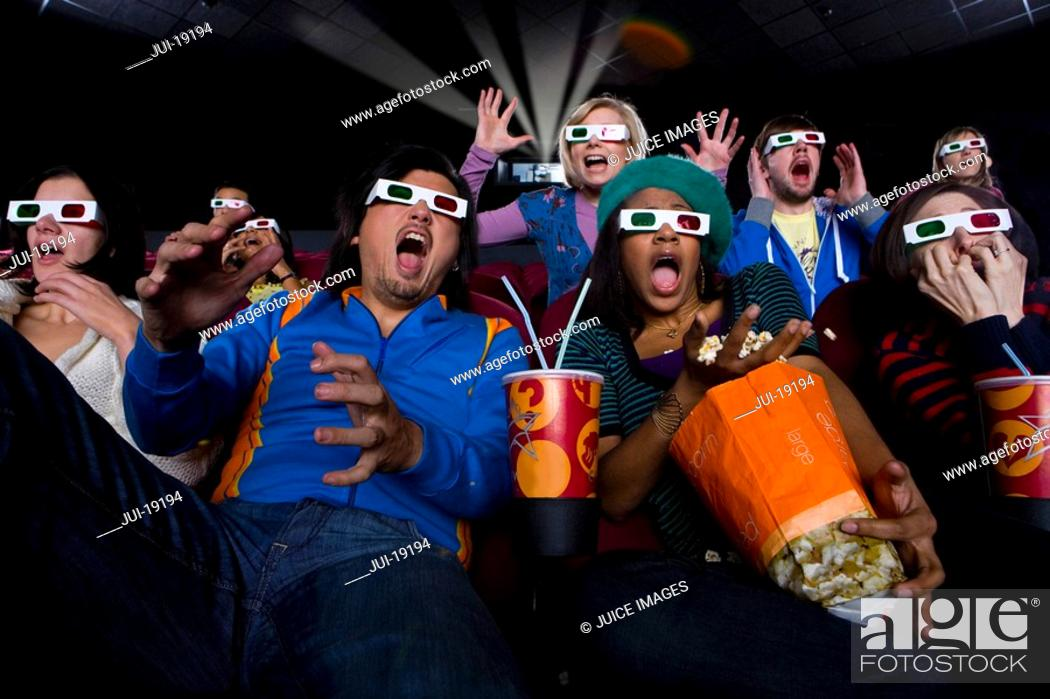 Stock Photo: Movie audience in 3D glasses, making faces, low angle view.