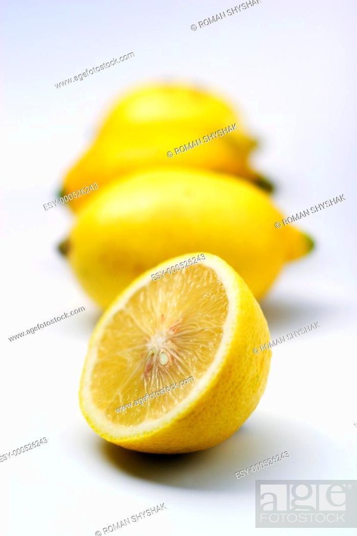 Stock Photo: Half of lemon on a white background against other lemons.
