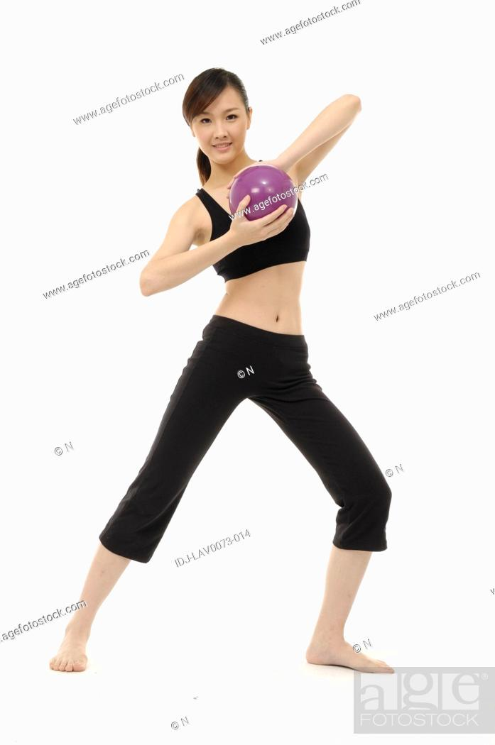 Stock Photo: Young woman practicing yoga with ball.