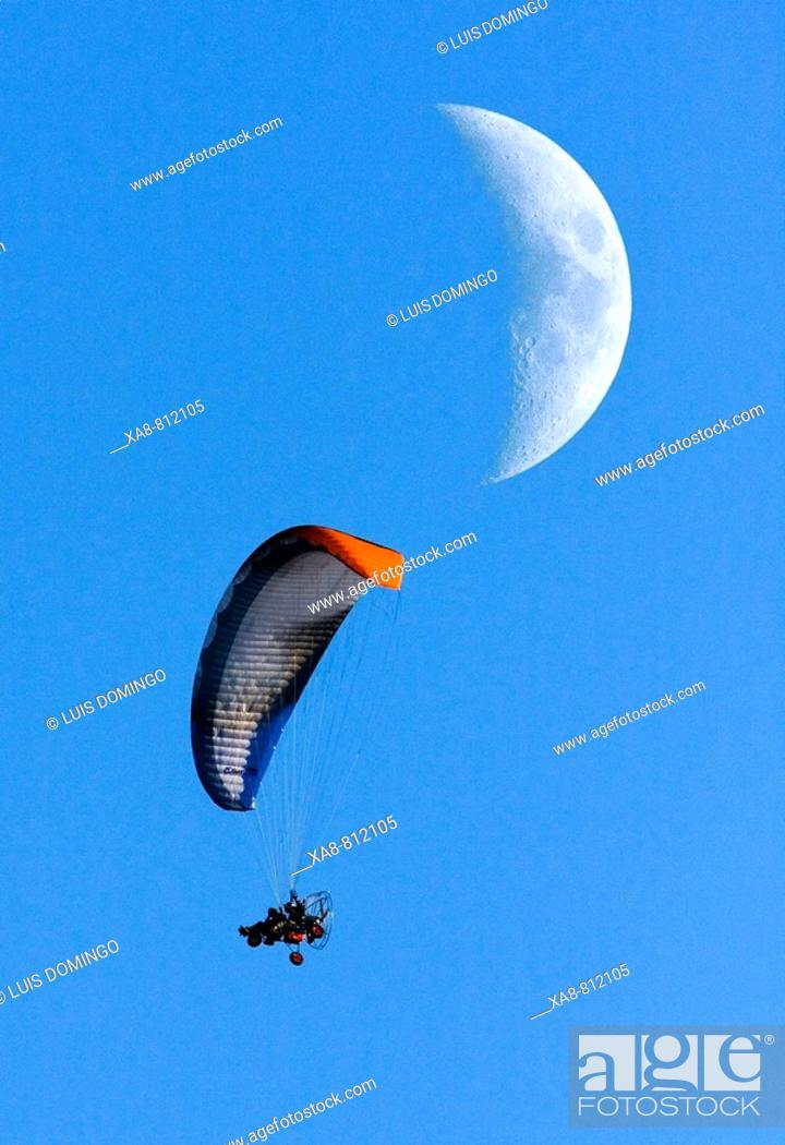 Stock Photo: Paramotor and moon, sport, risk.