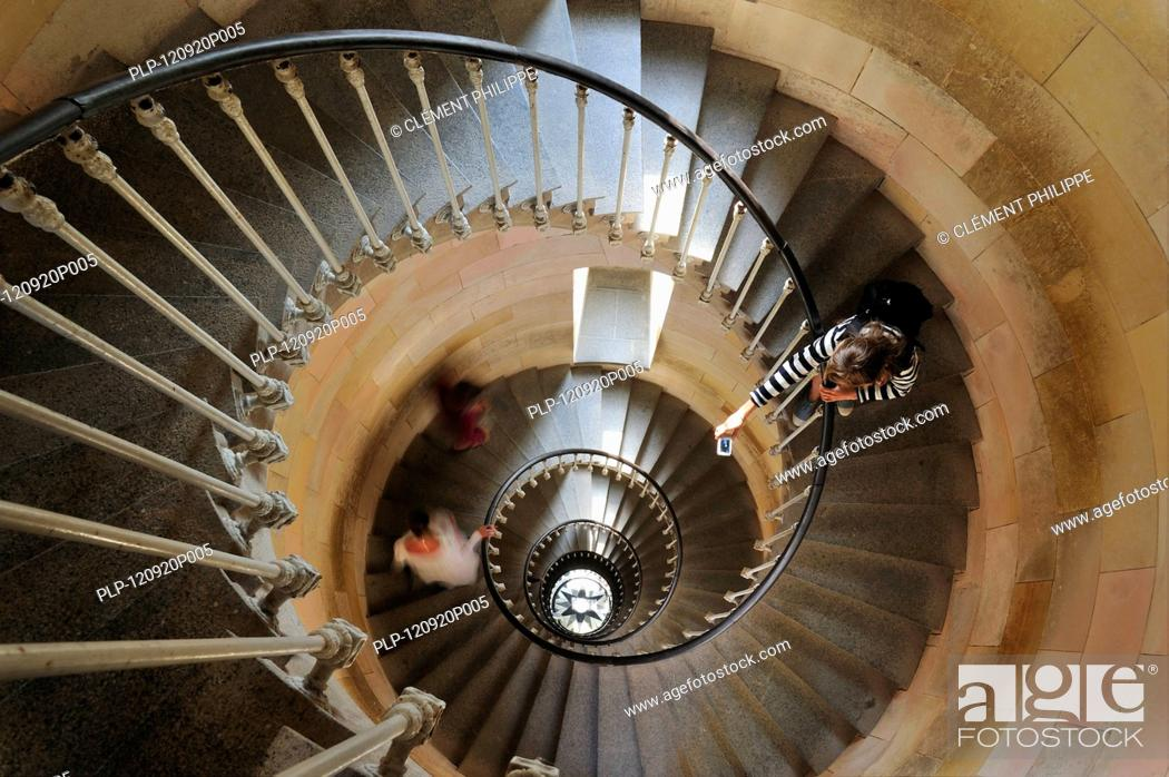 Stock Photo: Tourist taking picture of spiral staircase inside the lighthouse Phare des Baleines on the island Ile de Ré, Charente-Maritime, France.