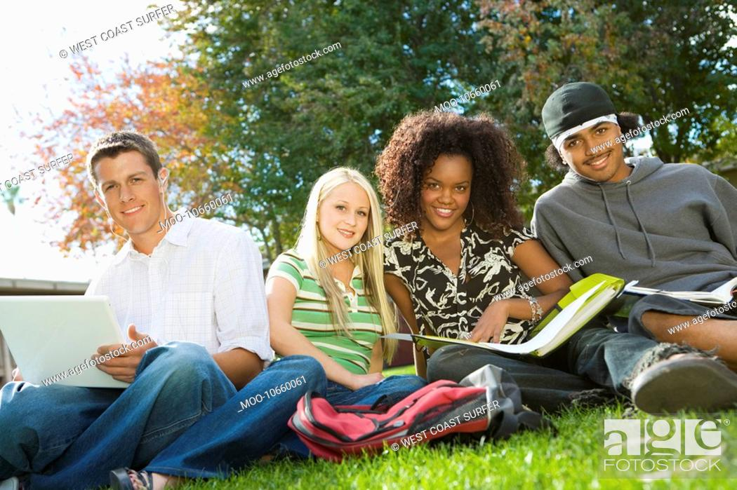 Stock Photo: Four students studying outdoors portrait.