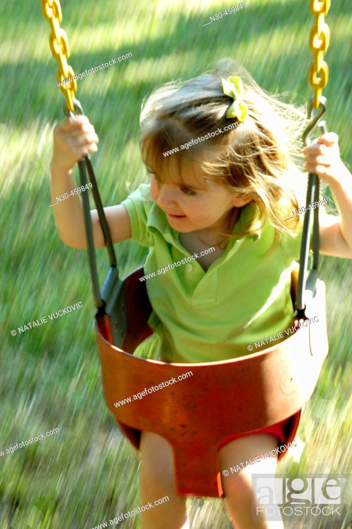 Stock Photo: Toddler Girl Swinging.