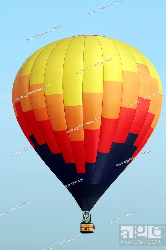 Stock Photo: Hot air balloons flying at the 30th Annual Quick Chek Festival of Ballooning at Thor Soldberg Airport in Readington, New Jersey The three day festival is one of.