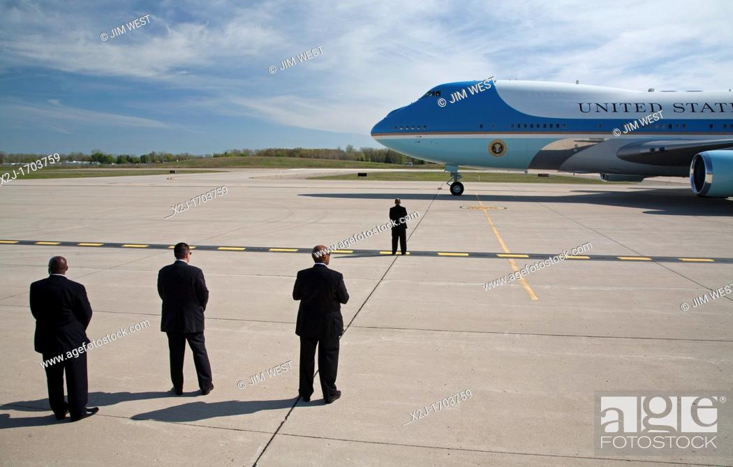 Stock Photo: Detroit, Michigan - Security personnel stand watch as President Barack Obama arrives at Detroit Metro Airport on Air Force 1.