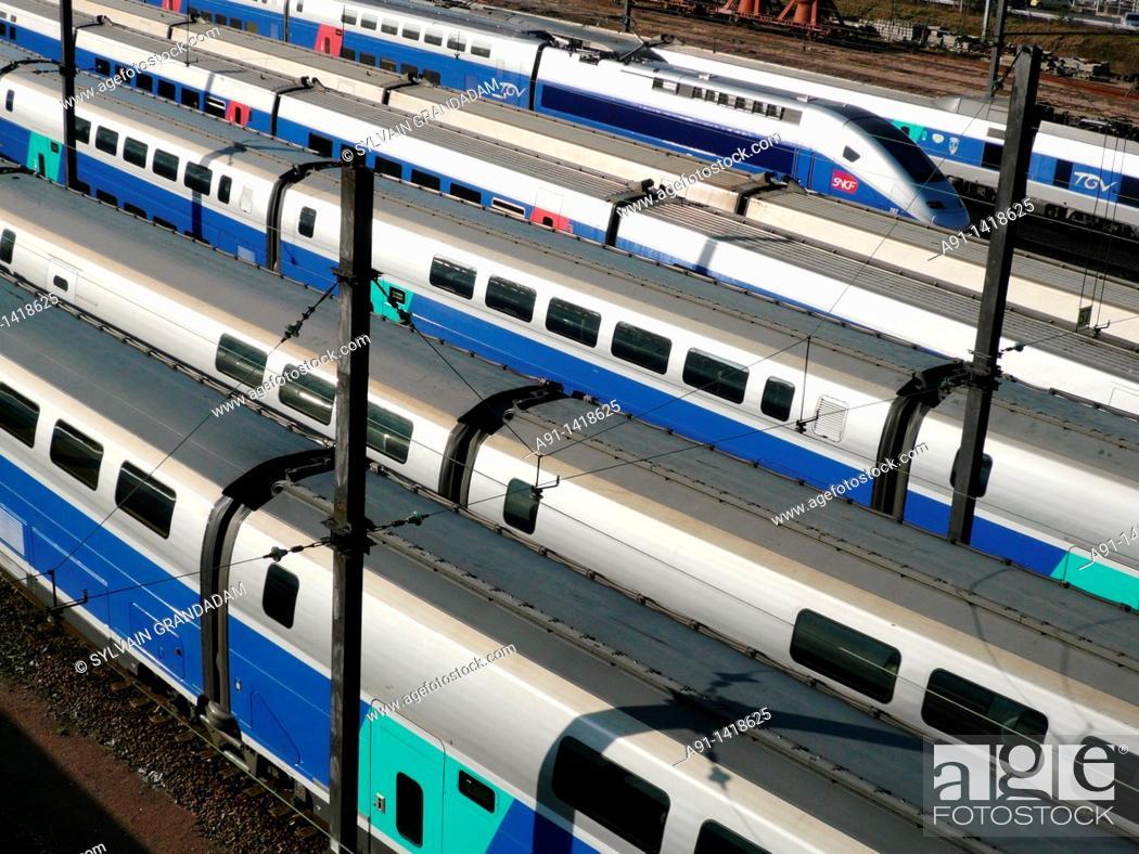 Stock Photo: France, Ile-de-France, Paris,TGV railway trains in Gare de Lyon station.