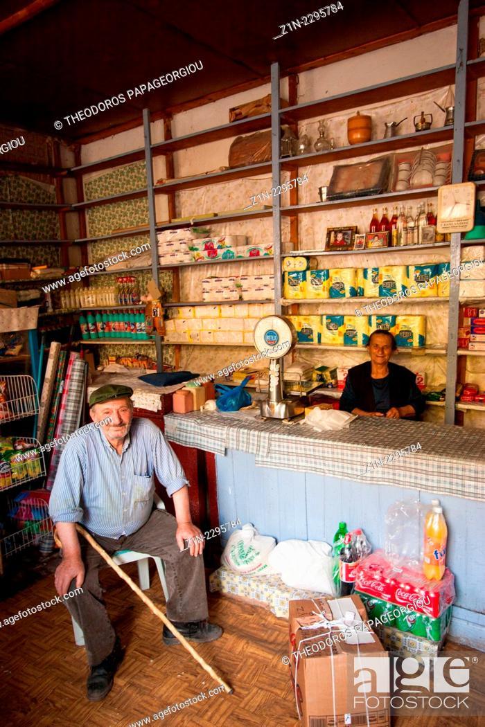 Stock Photo: Shopkeeper and customer at Kontovazena town. Arcadia, Peloponnese, Greece.