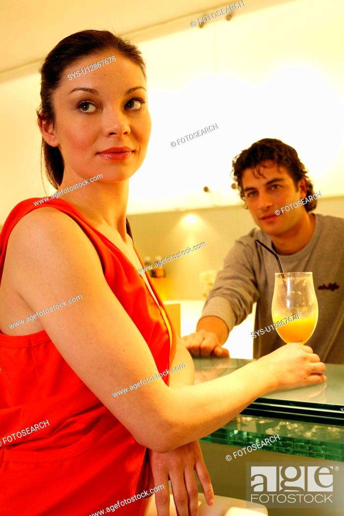 Stock Photo: Woman having a refreshment at the bar after a spa treatment.