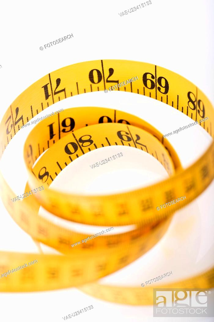 Stock Photo: Measuring tape in a pile.