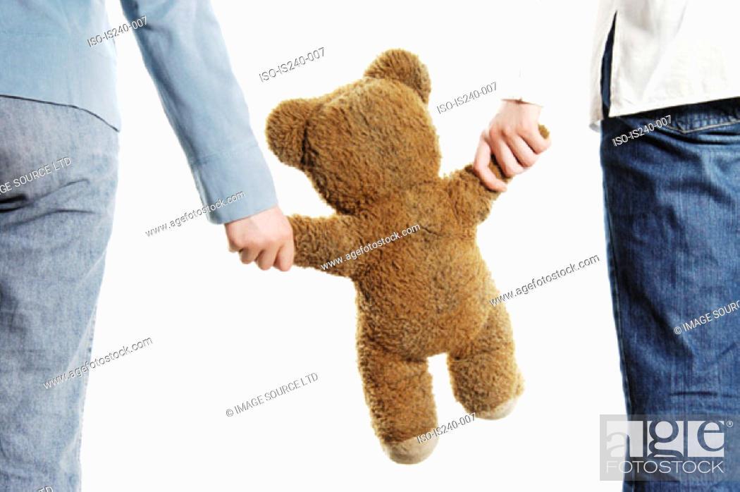 Stock Photo: Couple holding teddy bear.