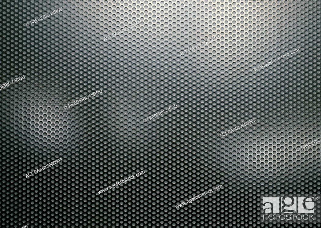 Stock Photo: Metal sheet perforated with holes, close-up, full frame.