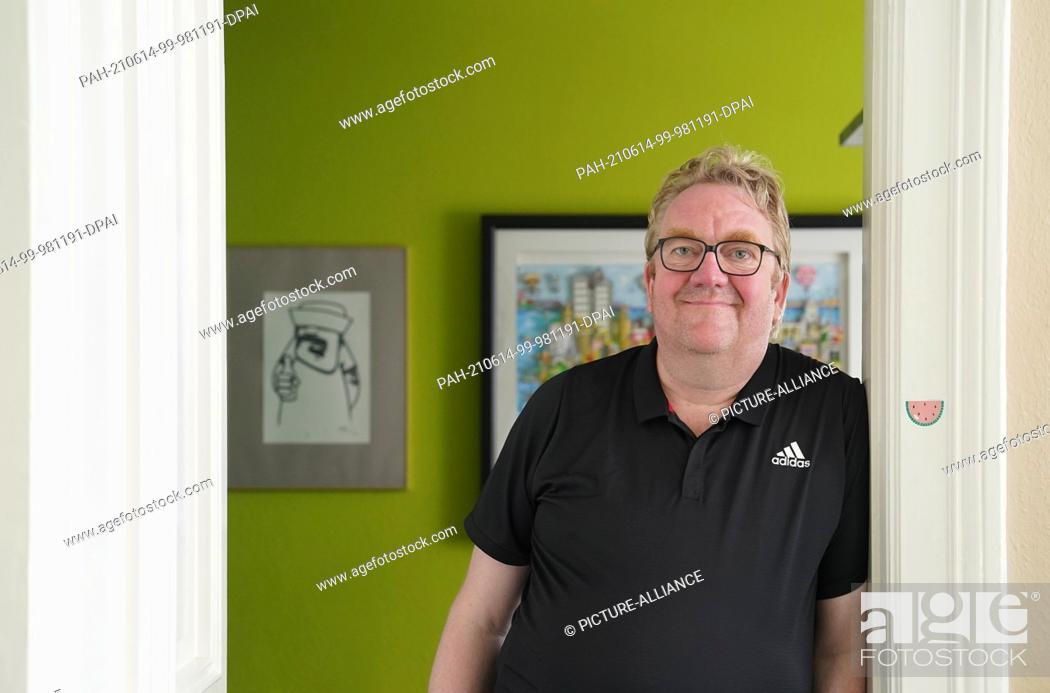 Stock Photo: 11 June 2021, Hamburg: Lars Meier, managing director of Gute Leude Fabrik and board member of the Hamburg charity MenschHamburg, stands in his office.