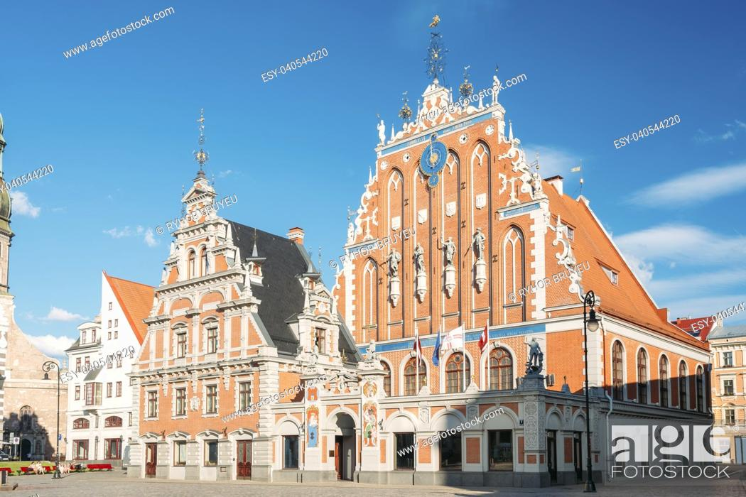 Stock Photo: Riga, Latvia. Schwabe House At Town Hall Square, Ancient Historical Landmark And Popular Touristic Showplace In Summer Sunny Day Under Blue Sky.