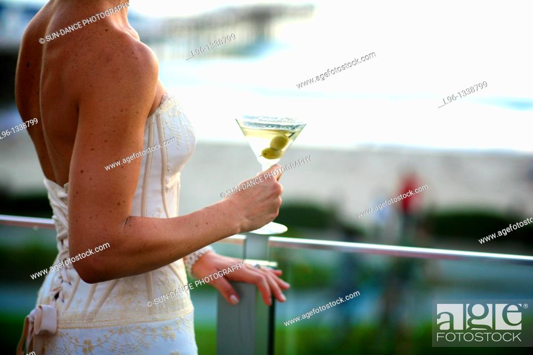 Stock Photo: Bride holding Martini glass.