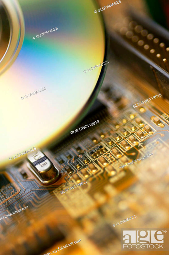 Stock Photo: Close-up of a CD and a circuit board.