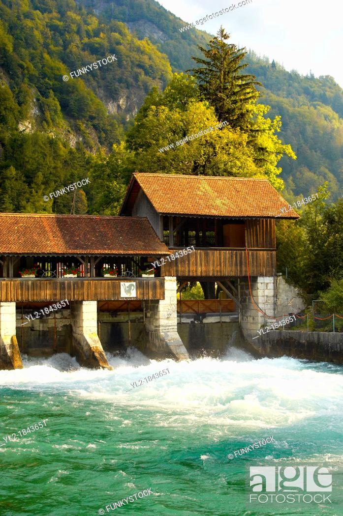 Stock Photo: Interlaken Bernese Alps Switzerland - River and wooden wier.
