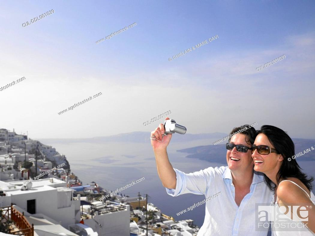 Stock Photo: Couple taking pictures, sea view.