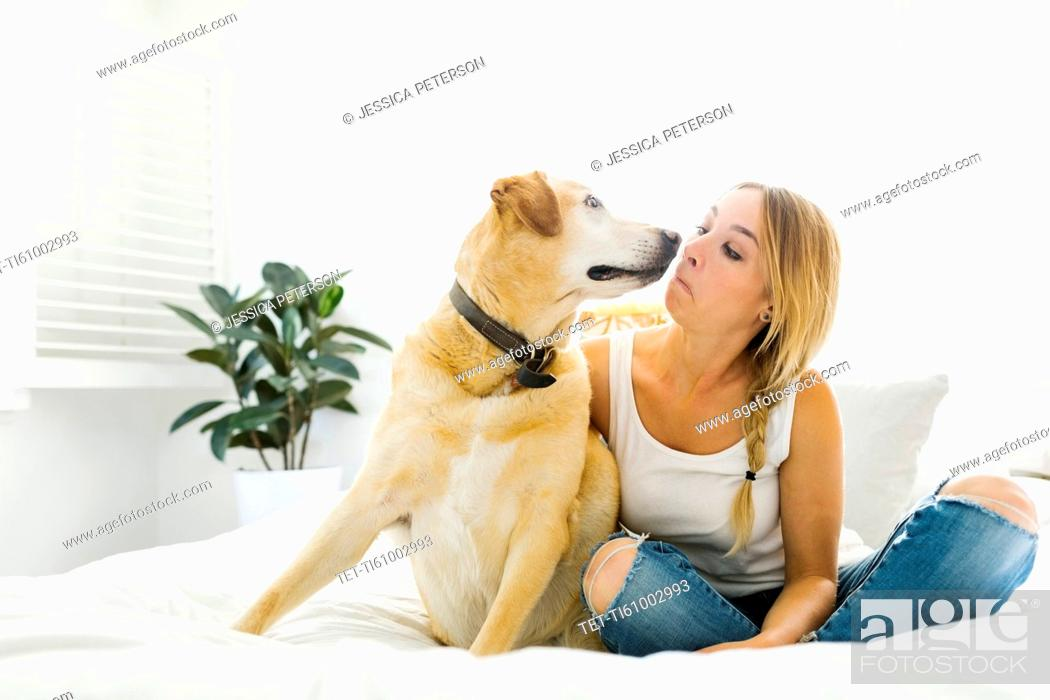 Stock Photo: Portrait of blond woman with golden retriever.